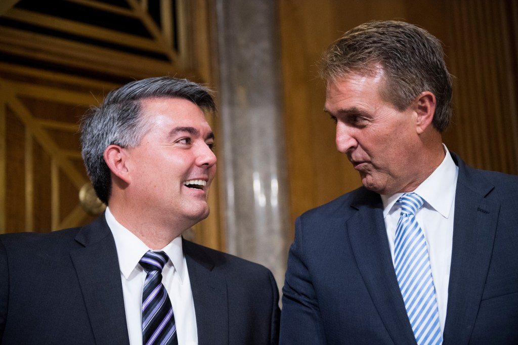 UNITED STATES - SEPTEMBER 19: Sen. Cory Gardner, R-Colo., left and Sen. Jeff Flake, R-Ariz., talk as they arrive for in the Senate Foreign Relations Committee for Jon Huntsman's confirmation hearing to be ambassador to the Russian Federation on Tuesday, Sept. 19, 2017. (Photo By Bill Clark/CQ Roll Call)