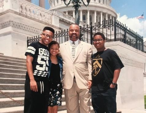Rep. Donald Payne Jr., with his triplets, XXX, XXX, and XXX. (Courtesy Payne's office)