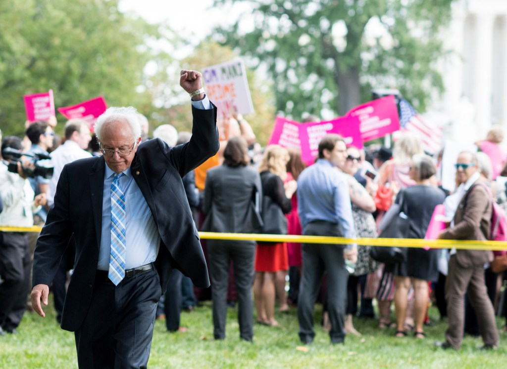 UNITED STATES - SEPTEMBER 19: Sen. Bernie Sanders, I-Vt., raises his fist as rally attendees chant
