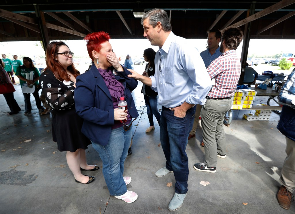 Ryan talks with 3rd District candidate Heather Ryan, no relation, during the event in Des Moines. (Charlie Neibergall/AP photo)