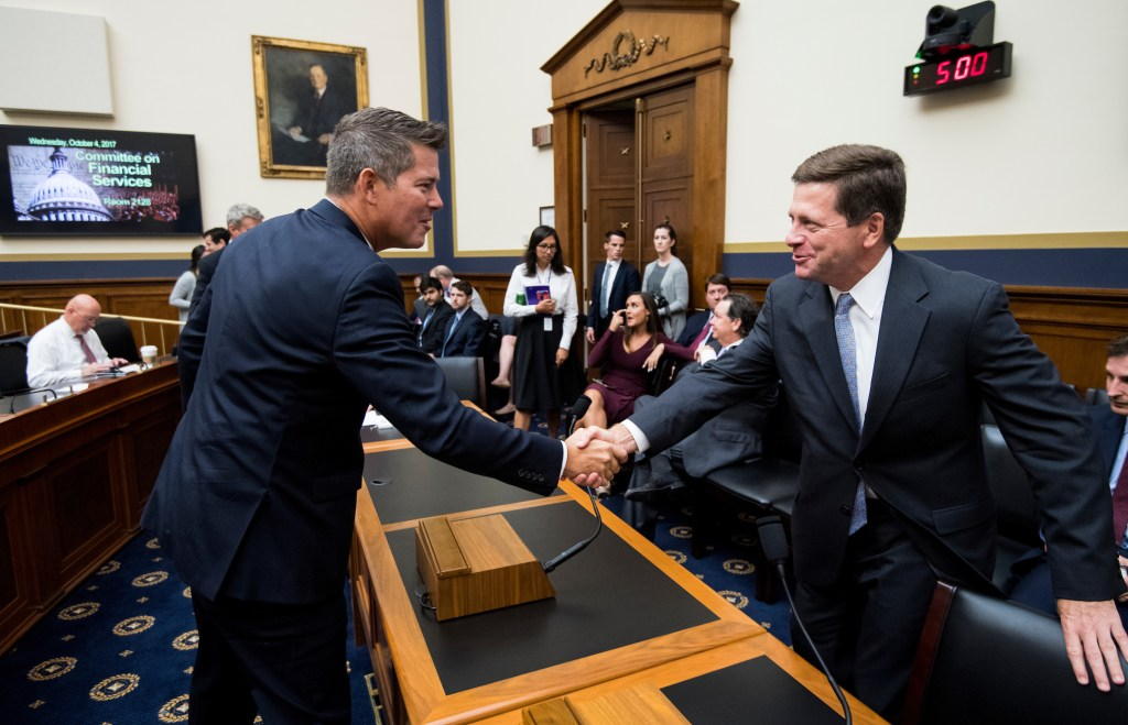 UNITED STATES - OCTOBER 4: Rep. Sean Duffy, R-Wisc., shakes hands with SEC Chairman Jay Clayton before the start of the House Financial Services Committee hearing on