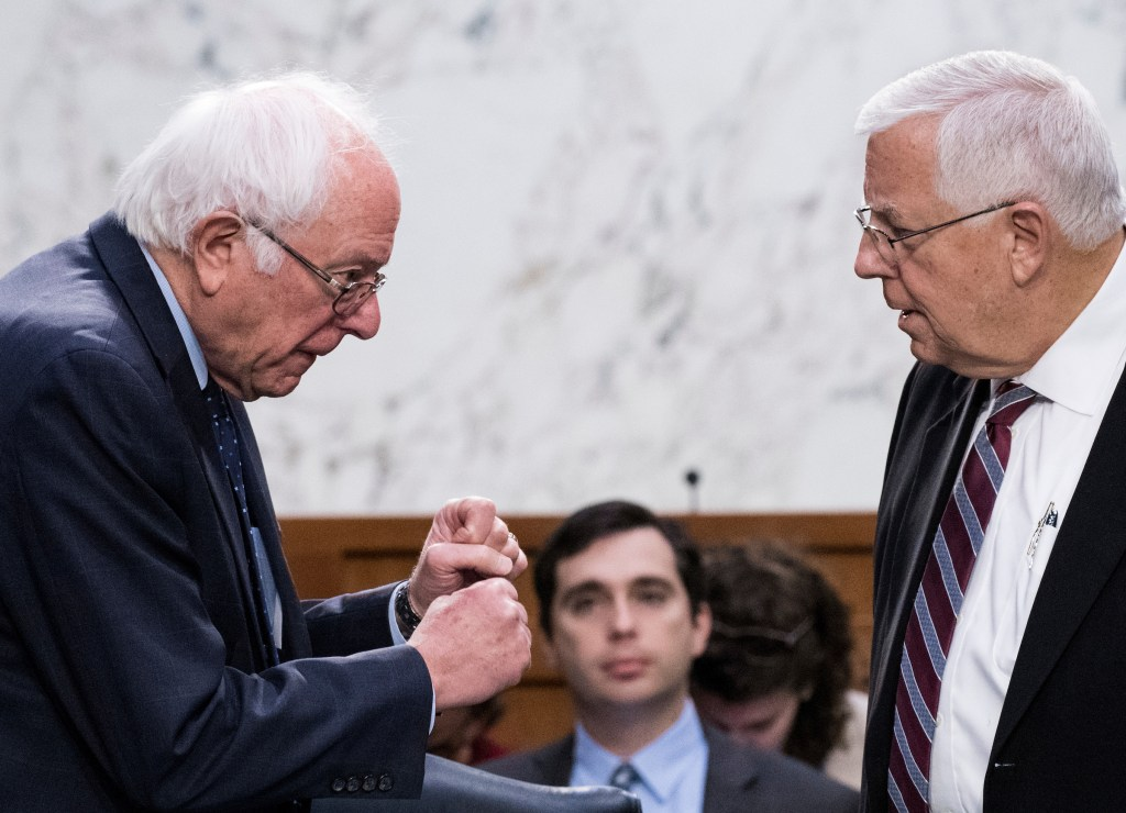 UNITED STATES - OCTOBER 5: From left, Senate Budget Committee ranking member Sen. Bernie Sanders, I-Vt., and chairman Sen. Mike Enzi, R-Wyo., talk before the start of the committee's federal budget mark up hearing on Thursday, Oct. 5, 2017. (Photo By Bill Clark/CQ Roll Call)