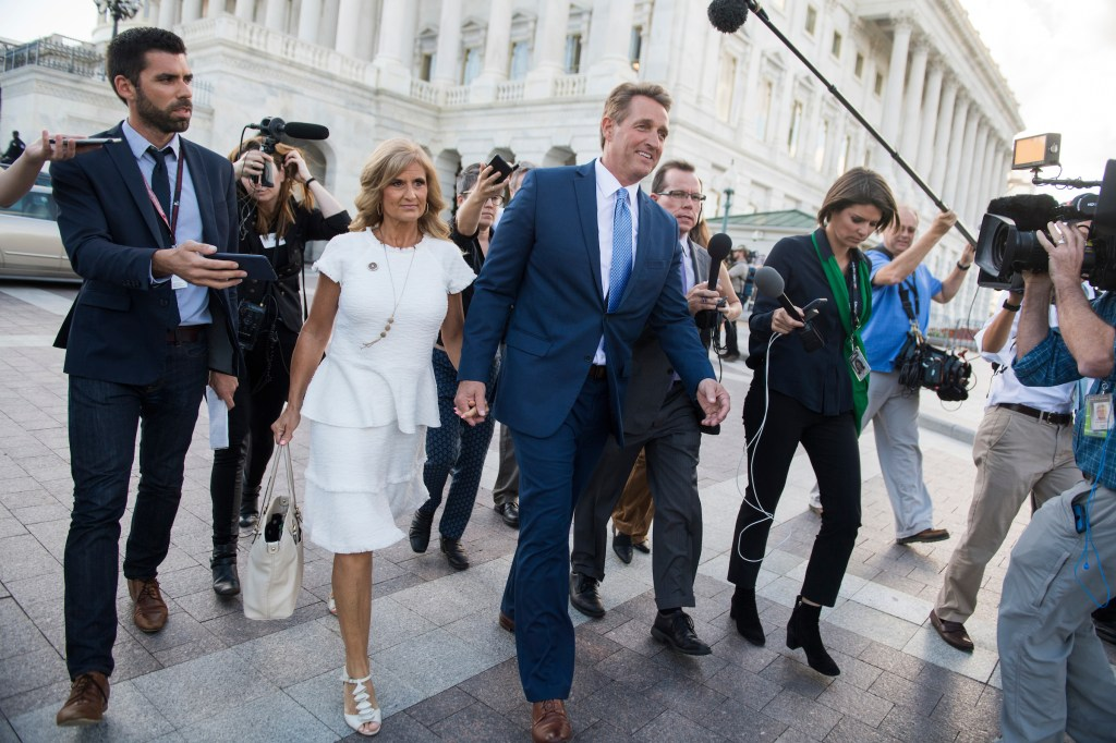 UNITED STATES - OCTOBER 24: Sen. Jeff Flake, R-Ariz., and his wife Cheryl, leave the Capitol on the day he announced he will not be running for re-election on October 24, 2017. (Photo By Tom Williams/CQ Roll Call)