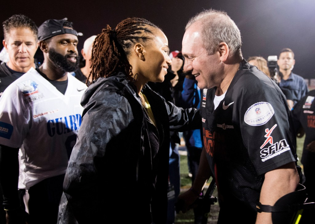 UNITED STATES - OCTOBER 11: Capitol Police officers David Bailey and Crystal Griner along with House Majority Whip Steve Scalise, R-La., participate in a halftime presentation during the Congressional Football Game at Gallaudet University in Washington on Wednesday, Oct. 11, 2017. The game featured the Capitol Police team The Guards vs the Congressional team The Mean Machine. (Photo By Bill Clark/CQ Roll Call)