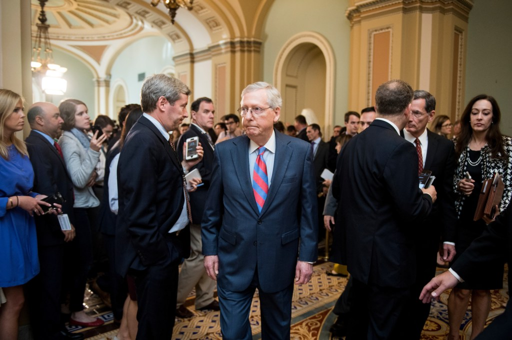 UNITED STATES - OCTOBER 3: Senate Majority Leader Mitch McConnell, R-Ky., walks back to his office after speaking to reporters in the Ohio Clock Corridor following the Senate Republicans' policy lunch in the Capitol on Tuesday, Oct. 3, 2017. (Photo By Bill Clark/CQ Roll Call)