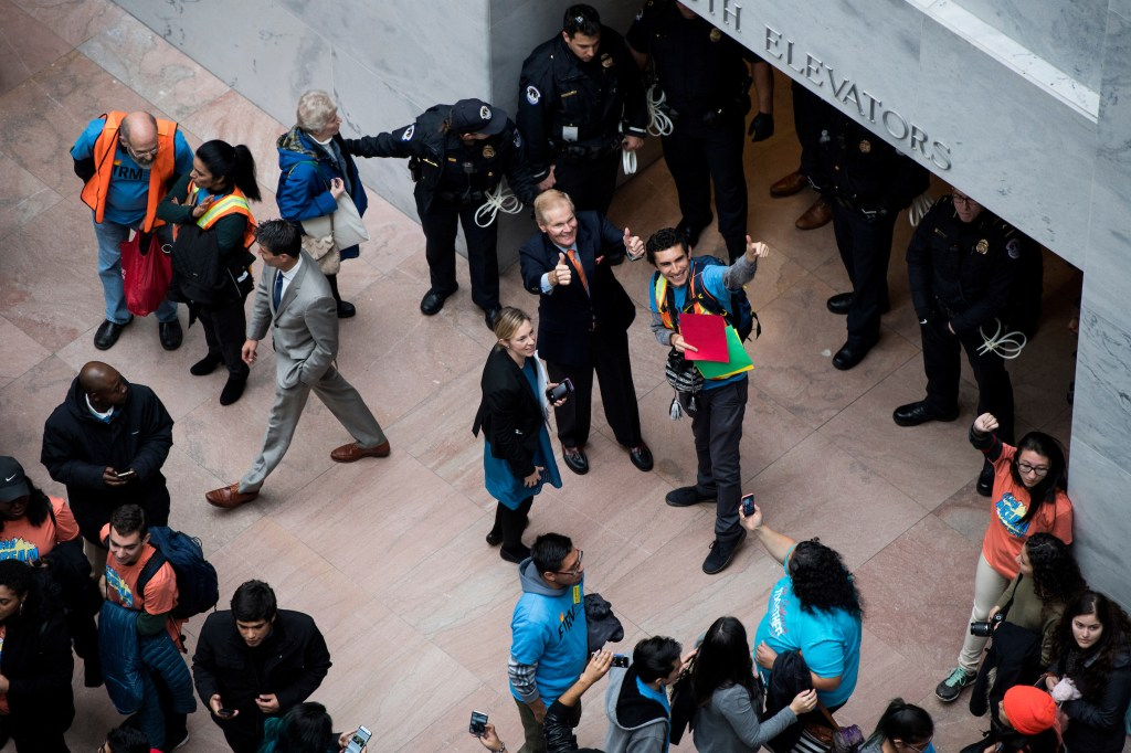 UNITED STATES - NOVEMBER 9: Sen. Bill Nelson, D-Fla., gives a thumbs up to protesters calling for a clean Dream Act in the Hart Senate Office Building on Thursday, Nov. 9, 2017. Protesters hung large banners from the upper floors and crowded the atrium before Capitol Police moved in to make arrests. (Photo By Bill Clark/CQ Roll Call)