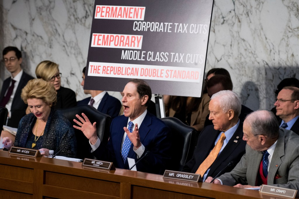 From left, Sen. Debbie Stabenow, D-Mich., ranking member Sen. Ron Wyden, D-Ore., chairman Sen. Orrin Hatch, R-Utah, and Sen. Chuck Grassley, R-Iowa, participate in the Senate Finance Committee markup of the