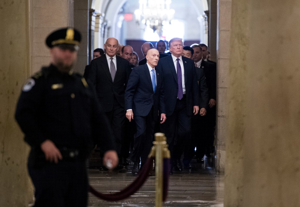 Trump, accompanied by his chief of staff John Kelly, arrives in the Capitol to speak to House Republicans before their vote on a tax bill. (Bill Clark/CQ Roll Call)