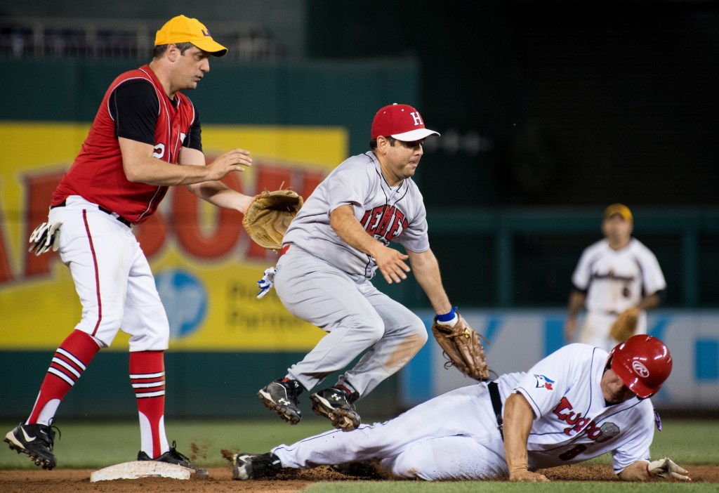 UNITED STATES - JUNE 15: Rep. Raul Ruiz, D-Calif., tags out Rep. Mike Bishop, R-Mich., at second base as Rep. Tim Ryan, D-Ohio, watches during the annual Congressional Baseball Game at Nationals Park in Washington on Thursday, June 15, 2017. (Photo By Bill Clark/CQ Roll Call)