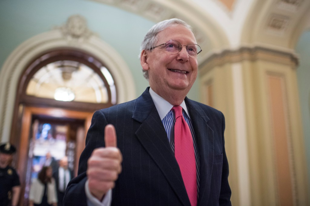 UNITED STATES - APRIL 6: Senate Majority Leader Mitch McConnell, R-Ky., gives a thumbs up after the Senate invoked the