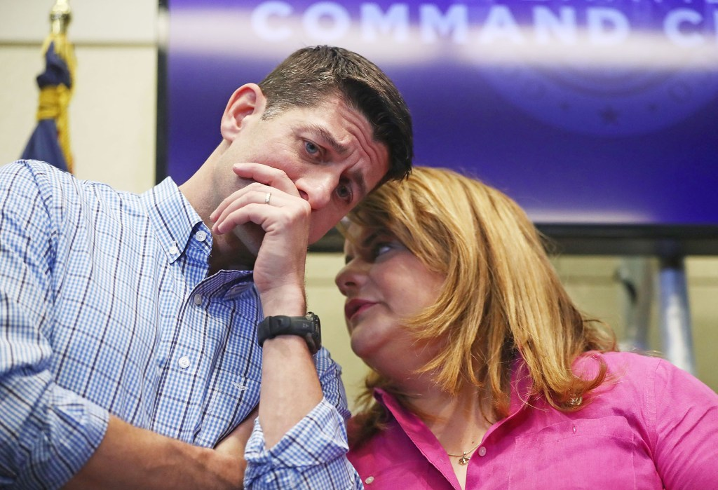 House Speaker Paul D. Ryan speaks with Puerto Rico Res. Cmmsr. Jenniffer González-Colón at a press conference on Oct. 13 in San Juan. Ryan led a delegation to visit areas damaged by Hurricane Maria. (Mario Tama/Getty Images file photo)