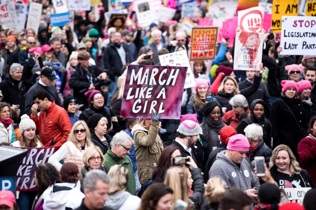UNITED STATES - JANUARY 21: Protesters march down Independence Avenue in Washington holding signs during the Women's March on Washington on Saturday, Jan. 21, 2017, the day after the Inauguration of Donald Trump as the 45th President of the United States. (Photo By Bill Clark/CQ Roll Call)