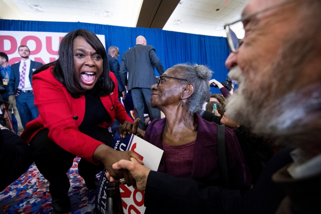 UNITED STATES - DECEMBER 12: Rep. Terri Sewell, D-Ala., shakes hands with supporters of Alabama Democrat Doug Jones after his victory over Judge Roy Moore at the Sheraton in Birmingham, Ala., on Tuesday, Dec. 12, 2017. Jones faced off against Judge Roy Moore in a special election for Jeff Sessions' seat in the U.S. Senate. (Photo By Bill Clark/CQ Roll Call)