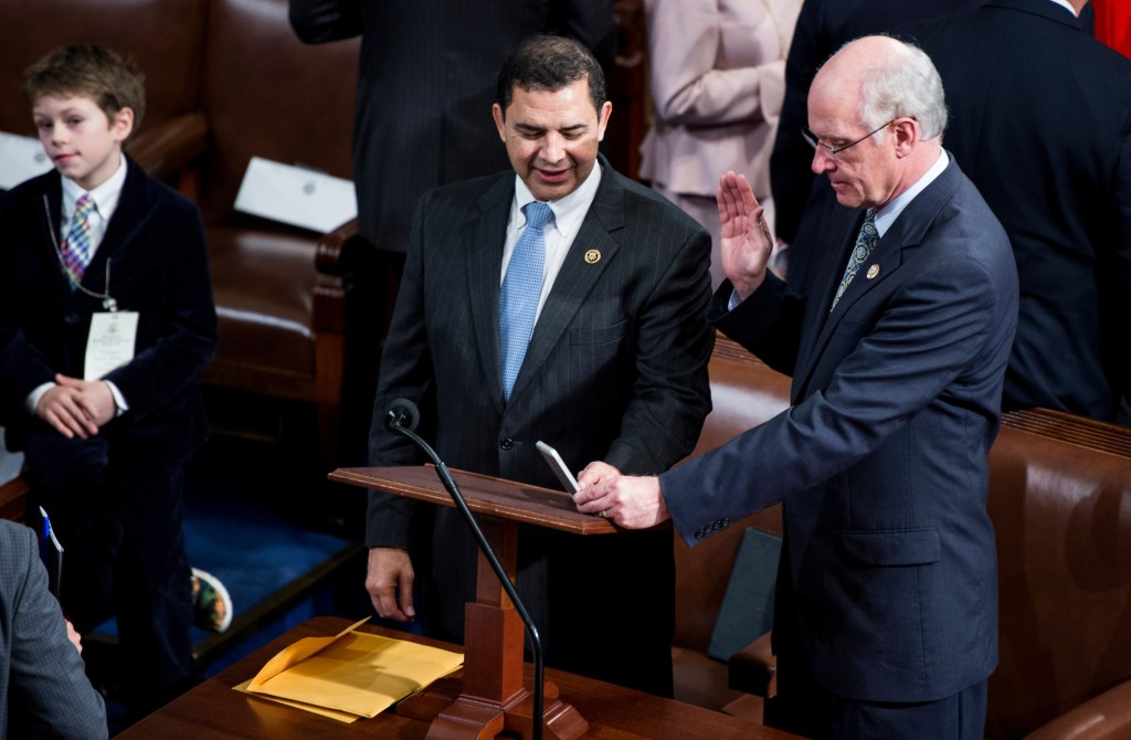 Rep. Henry Cuellar, D-Texas, left, helps Rep. Bill Keating, D-Mass., take a selfie photo on the House floor before the official swearing in of the 115th Congress convenes on Tuesday, Jan. 3, 2017. (Photo By Bill Clark/CQ Roll Call)