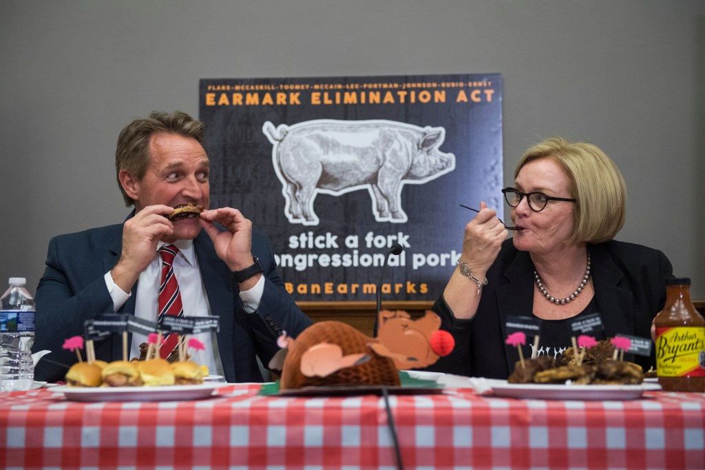 Sens. Jeff Flake, R-Ariz., and Claire McCaskill, D-Mo., eat barbecue during an event in Russell Building to introduce the Earmark Elimination Act and demonstrate that Congress can