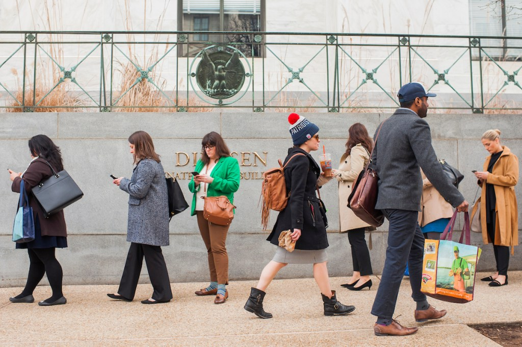 UNITED STATES - JANUARY 22: Hill staffers and others wait in a long line to enter Dirksen Building as only certain doors to the Senate office buildings were open while Congress works to end the government shutdown on January 22, 2018. (Photo By Tom Williams/CQ Roll Call)
