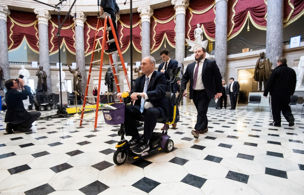 UNITED STATES - JANUARY 30: House Majority Whip Steve Scalise, R-La., rides by as techinicians set up lighting in Statuary Hall in preparation for President Donald Trumps' first State of the Union Address on Tuesday, Jan. 30, 2018. (Photo By Bill Clark/CQ Roll Call)