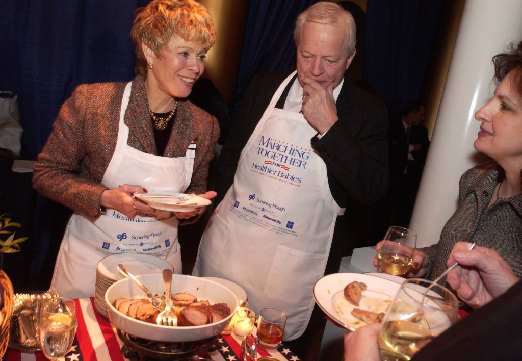gala4/030502 - Rep. Joe Knollenberg, R-Mich., and his wife Sandie, serve hors d'oeuvre from their region of the country, to guests at the March of Dimes Bipartisan Gala. The event which raised $1 million at last year, featured members of Congress and the Bush Administration.