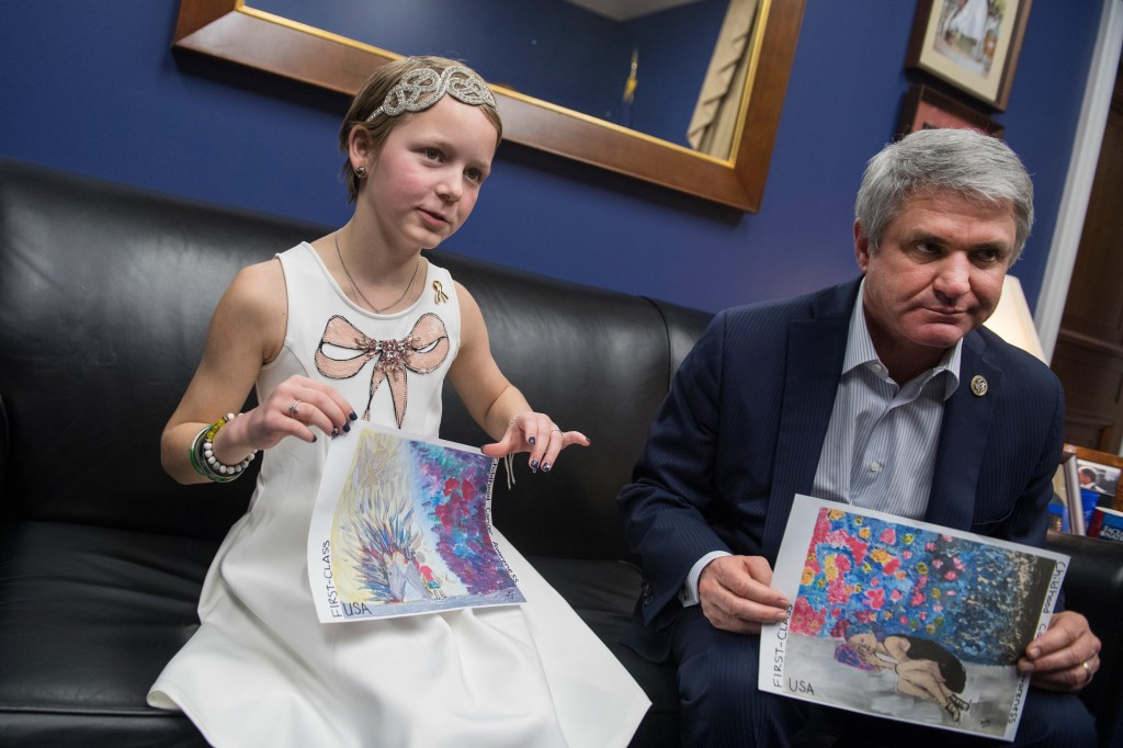 UNITED STATES - FEBRUARY 05: Sadie Keller, 10, a cancer survivor from Texas, and Rep. Michael McCaul, R-Texas, are interviewed in McCaul's Rayburn Building office on February 5, 2018. They hold examples of Sadie's artwork. (Photo By Tom Williams/CQ Roll Call)