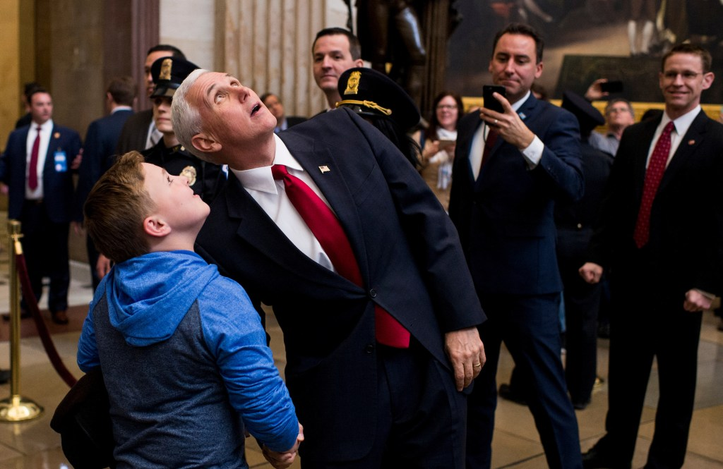 UNITED STATES - MARCH 21: Vice President Mike Pence shakes hands with a young tourist as they look up in the Capitol rotunda on Tuesday, March 21, 2017. Pence stopped to shake hands with tourists as he was leaving the Senate Republicans' policy lunch. (Photo By Bill Clark/CQ Roll Call)