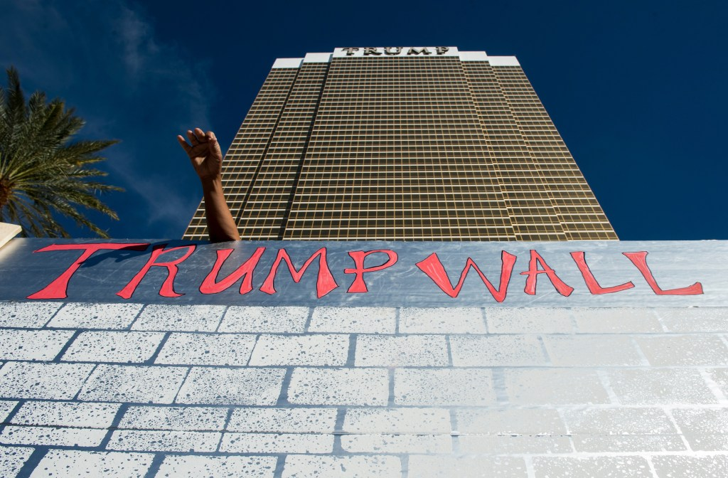 UNITED STATES - OCTOBER 19: Protesters erect a cardboard wall in front of the Trump International Hotel Las Vegas during the Culinary Union's Wall of Taco Trucks protest the day of the final Presidential debate in Las Vegas on Oct. 19, 2016. (Photo By Bill Clark/CQ Roll Call)