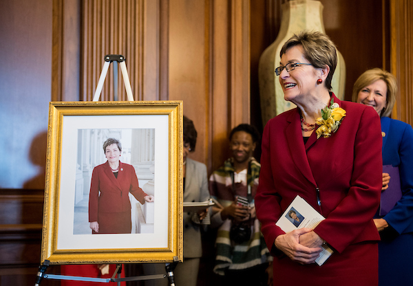 Rep. Marcy Kaptur, D-Ohio, stands next to a picture of herself as House Minority Leader Nancy Pelosi, D-Calif., hosts a reception in Kaptur's honor in the Capitol on Wednesday. The reception was held to honor Kaptur passing the milestone as the longest-serving woman in House history. She will break the record currently held by Rep. Edith Nourse Rogers, R-Mass., on Sunday, March 18. (Bill Clark/CQ Roll Call)