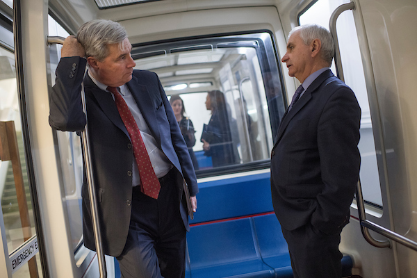 UNITED STATES - MARCH 13: Sens. Jack Reed, D-R.I., right, and Sheldon Whitehouse, D-R.I., ride the subway to Hart Building after the Senate Policy luncheons in the Capitol on March 13, 2018. (Photo By Tom Williams/CQ Roll Call)