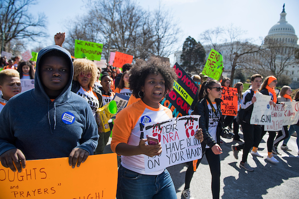 A group from Pittsburgh marches down the West Front of the Capitol to join the student-led March for Our Lives rally on Pennsylvania Avenue to call for action to prevent gun violence on March 24, 2018. (Photo By Tom Williams/CQ Roll Call)