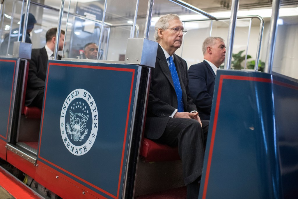 Senate Majority Leader Mitch McConnell, R-Ky., boards the Senate subway to Russell Building in the basement of the Capitol on February 27, 2018. (Photo By Tom Williams/CQ Roll Call)
