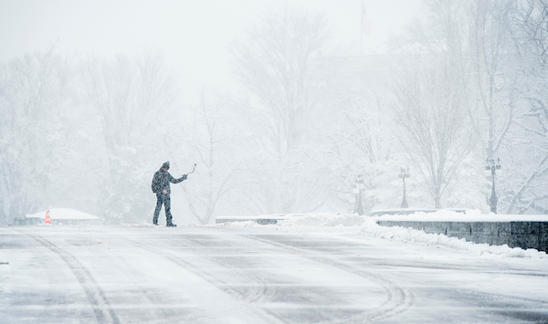 A tourist takes a selfie in front of the Capitol during the snow storm. (Bill Clark/CQ Roll Call)