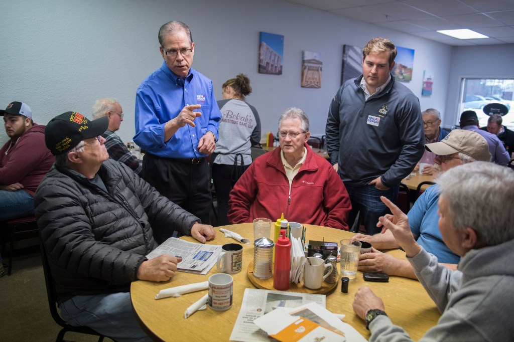 UNITED STATES - APRIL 4: Mike Braun, standing at left, who is running for the Republican nomination for Senate in Indiana, talks with patrons of Bekah's Westside Cafe in Lebanon, Ind., on April 4, 2018. (Photo By Tom Williams/CQ Roll Call)