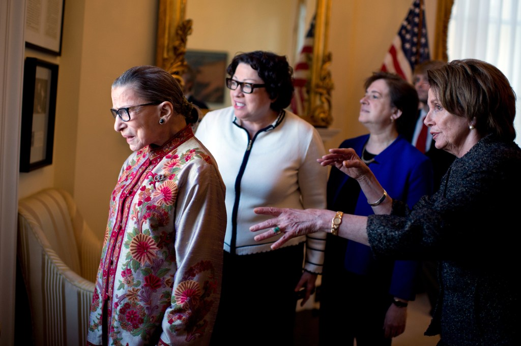 House Minority Leader Nancy Pelosi, D-Calif., right, shows a view of the Supreme Court from her Capitol office to Justices Ruth Bader Ginsburg, left, Sonia Sotomayor, in white, and Elena Kagan before a reception, March 18, 2015. The Justices were in the Capitol to be honored at Pelosi's annual Women's History Month reception in Statuary Hall. (Photo By Tom Williams/CQ Roll Call)