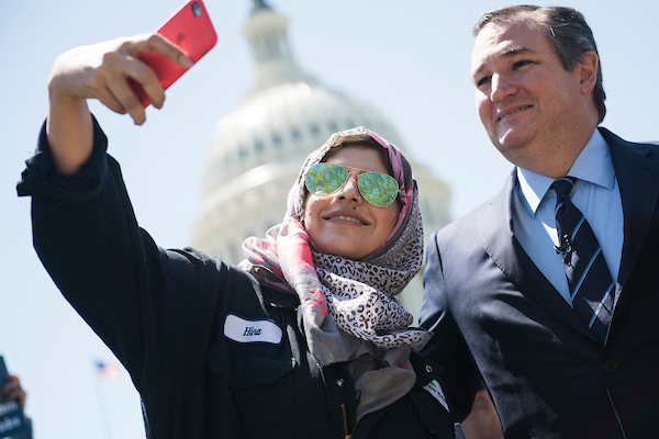 UNITED STATES - APRIL 26: Sen. Ted Cruz, R-Texas, takes a selfie with Hina Kanwel, of Monroe Energy, during a news conference on