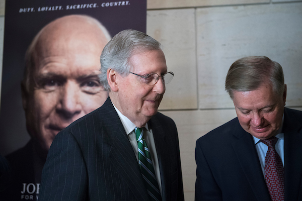 UNITED STATES - MAY 17: Senate Majority Leader Mitch McConnell, R-Ky., left, and Sen. Lindsey Graham, R-S.C., attend a reception in the Capitol Visitor Center before a film screening of HBO's documentary