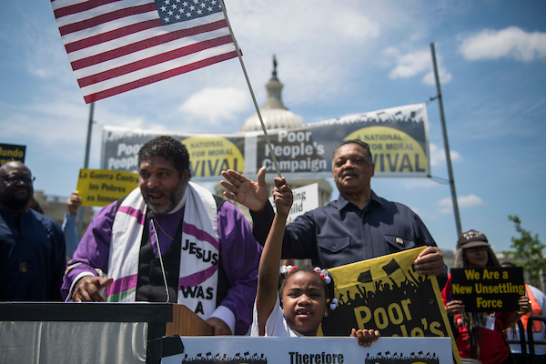 UNITED STATES - MAY 21: Revs. William Barber, left, Jesse Jackson, and Romiah Short, 7, attend a rally on the east front lawn of the Capitol with members of the Poor People's Campaign to call on lawmakers to address the