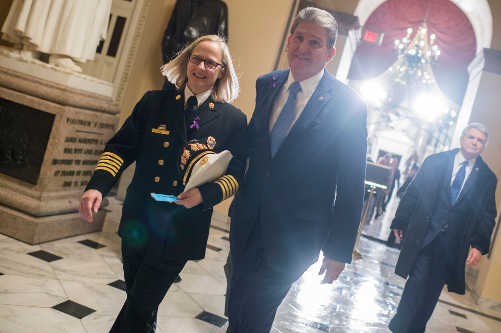 UNITED STATES - JANUARY 30: Sen. Joe Manchin, D-W.Va., and his guest Jan Rader, Fire Chief of Huntington, W.Va., are seen before President Donald Trump's State of the Union address to a joint session of Congress in the House chamber on January 30, 2018. (Photo By Tom Williams/CQ Roll Call)