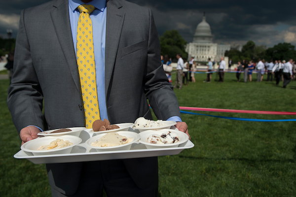 United States - June 6: Capitol Hill staffers enjoy the 36th Annual Capitol Hill Ice Cream Party hosted by The International Dairy Foods Association at Union Square Wednesday afternoon June 6, 2018. (Photo by Sarah Silbiger/CQ Roll Call)