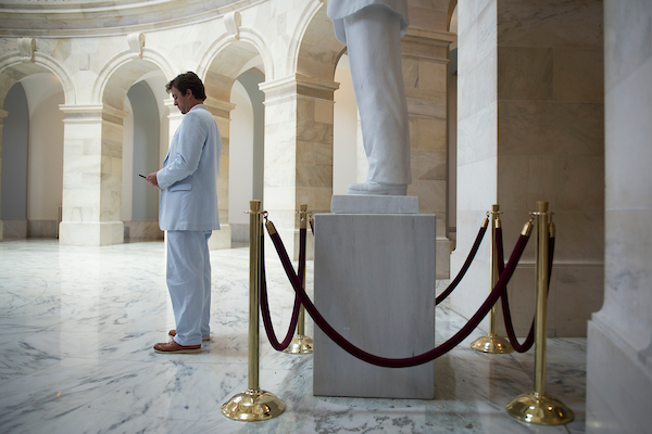 A congressional staffer participates in Seersucker Thursday in the Russell Senate Office Building rotunda June 7, 2018. (Photo By Sarah Silbiger/CQ Roll Call)