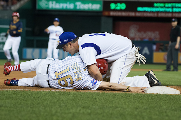 UNITED STATES - JUNE 14: Rep. Tim Ryan, D-Ohio, right, tags out Rep. Fred Upton, R-Mich., at third base during the 57th annual Congressional Baseball Game at Nationals Park on June 14, 2018. The Democrats prevailed 21-5. (Photo By Tom Williams/CQ Roll Call)