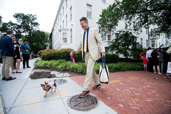 Rep. Roger Marshall, R-Kan., leaves the House Republican Conference meeting at the Capitol Hill Club in Washington with his wife's dog Pepper on Wednesday morning, June 13, 2018. (Photo By Bill Clark/CQ Roll Call)