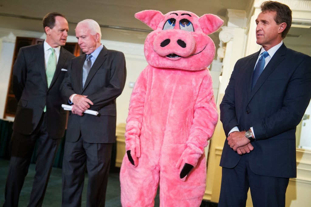 UNITED STATES - MAY 13: From left, Sens. Pat Toomey, R-Pa., John McCain, R-Ariz., Pigfoot, a mascot for Citizens Against Government Waste, and Sen. Jeff Flake, R-Ariz., attend a news conference at the Phoenix Park Hotel to release the 2015 Congressional Pig Book which identifies pork-barrel spending in Congress, May 13, 2015. (Photo By Tom Williams/CQ Roll Call)