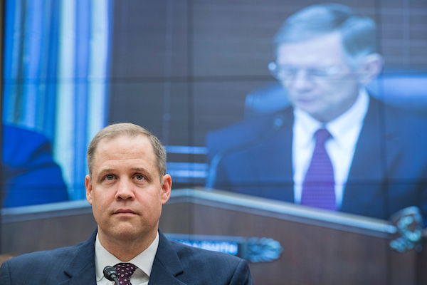 UNITED STATES - JULY 25: NASA Administrator Jim Bridenstine, left, and Chairman Lamar Smith, R-Texas, on a monitor, are seen during a House Science, Space, and Technology Committee hearing titled