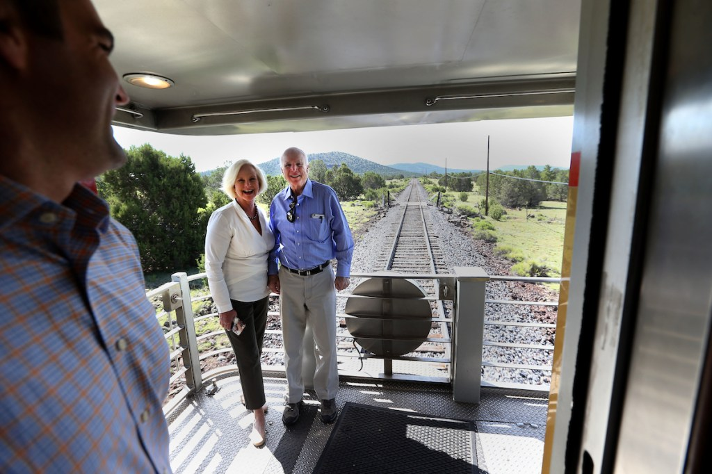 A McCain staffer prepares to tweet an image out of United States Senator John McCain and his wife Cindyas they ride the train to the Grand Canyon out of Williams, Arizona Wednesday morning. (Photograph by Daniel A. Anderson)