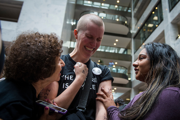 A woman cries in the Hart Senate Office Building atrium as Ford testifies. (Sarah Silbiger/CQ Roll Call)