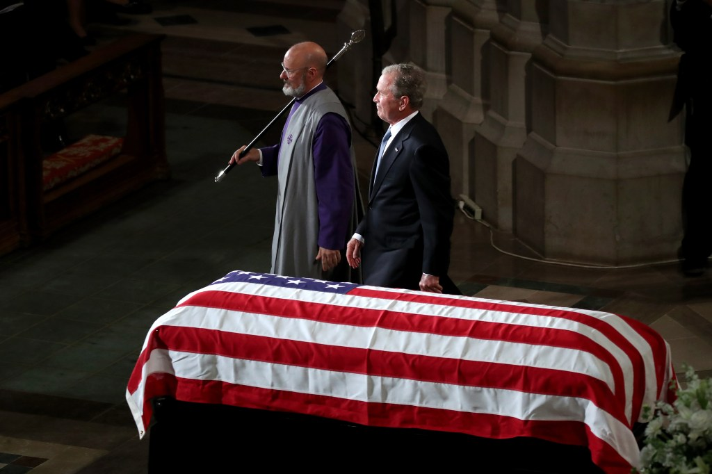 WASHINGTON, DC - SEPTEMBER 1:  Former U.S. President George W. Bush (R) leaves the podium after speaking during the funeral service for U.S. Sen. John McCain at the National Cathedral  on September 1, 2018 in Washington, DC. The late senator died August 25 at the age of 81 after a long battle with brain cancer. McCain will be buried at his final resting place at the U.S. Naval Academy. (Photo by Mark Wilson/Getty Images)