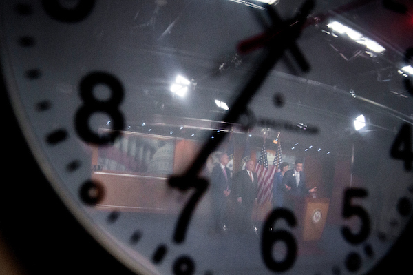 UNITED STATES - SEPT 13: Speaker of the House Rep. Paul Ryan, R-Wis., is seen through a wall clock speaking during a press conference alongside House Republican Leaders in the House Studio Thursday, Sept. 13, 2018. (Photo By Sarah Silbiger/CQ Roll Call)