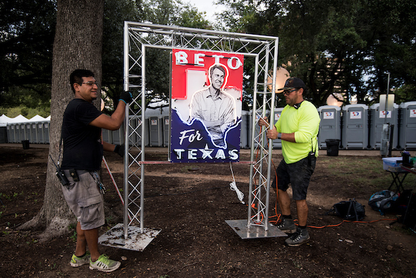Workers move a neon Beto sign into place before the start of Democratic candidate for U.S. Senate from Texas Rep. Beto O'Rourke's Turn out For Texas Rally, featuring a concert by Wille Nelson, in Austin, Texas on Saturday, Sept. 29, 2018. (Photo By Bill Clark/CQ Roll Call)