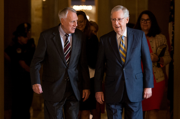 Former Sen. Jon Kyl, R-Ariz., left, walks with Senate Majority Leader Mitch McConnell, R-Ky., to the Senate floor in the Capitol to be sworn in as the Senator to fill Sen. John McCain's seat on Wednesday, Sept. 5, 2018. (Photo By Bill Clark/CQ Roll Call)