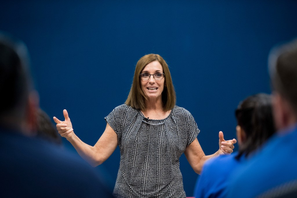 GOP candidate for Senate Rep. Martha McSally, R-Ariz., speaks to students after touring the Universal Technical Institute. (Bill Clark/CQ Roll Call)