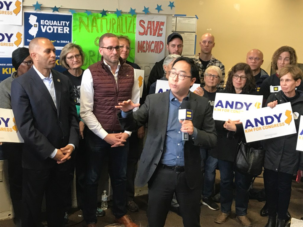 Democrat Andy Kim, center, campaigns for New Jersey's 3rd District with New York Rep. Hakeem Jeffries, far left, and Human Rights Campaign president Chad Griffin, second from left, in Willingboro, New Jersey. (Simone Pathe/CQ Roll Call)